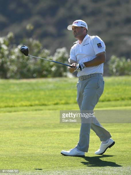 Ryan Palmer plays his second shot on the sixth hole during the final round of the Farmers Insurance Open at Torrey Pines South on January 28 2018 in...