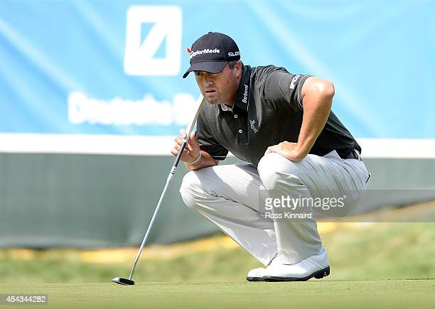 Ryan Palmer prepares to putt on the 18th during the first round of the Deutsche Bank Championship at the TPC Boston on August 29 2014 in Norton...