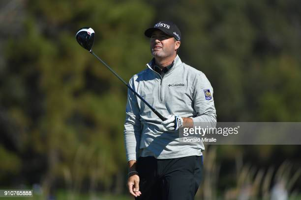 Ryan Palmer reacts after playing his shot from the 14th tee during the second round of the Farmers Insurance Open at Torrey Pines North on January 26...
