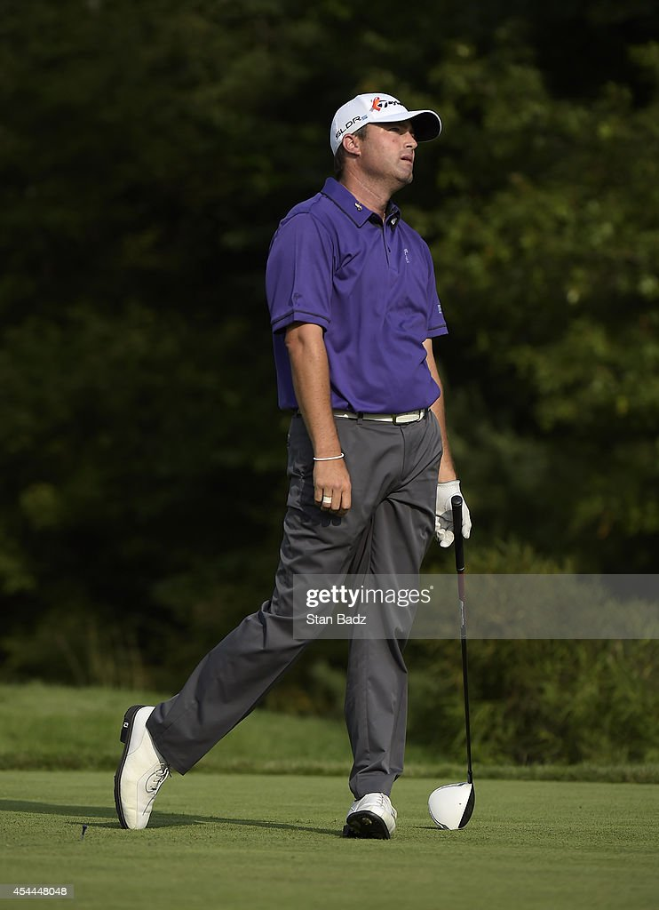 Ryan Palmer reacts to his drive on the 14th hole during the third round of the Deutsche Bank Championship at TPC Boston on August 31, 2014 in Norton, Massachusetts.