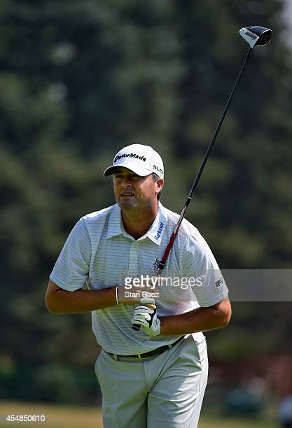 Ryan Palmer tracks his drive on the third hole during the third round of the BMW Championship at Cherry Hills Country Club on September 6 2014 in...