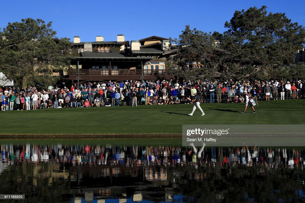 Ryan Palmer walks up the on the 18th hole fairway during the third round of the Farmers Insurance Open at Torrey Pines South on January 27, 2018 in San Diego, California.