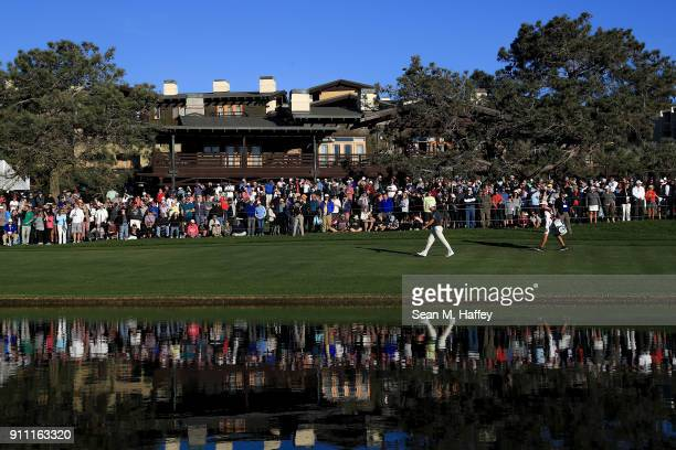Ryan Palmer walks up the on the 18th hole fairway during the third round of the Farmers Insurance Open at Torrey Pines South on January 27 2018 in...