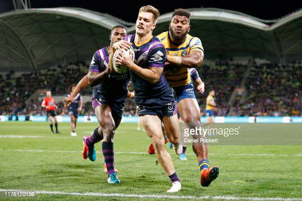 Ryan Papenhuyzen of the Storm and Maiko Sivo of the Eels contest the ball during the NRL Semi Final match between the Melbourne Storm and the...