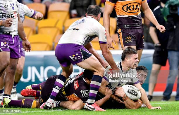 Ryan Papenhuyzen of the Storm celebrates scoring a try during the round 11 NRL match between the Brisbane Broncos and the Melbourne Storm at Suncorp...