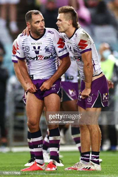 Ryan Papenhuyzen of the Storm embraces Cameron Smith of the Storm following a late Panthers try with seconds remaining on the clock during the 2020...