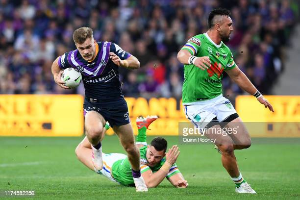 Ryan Papenhuyzen of the Storm makes a break during the NRL Qualifying Final match between the Melbourne Storm and the Canberra Raiders at AAMI Park...