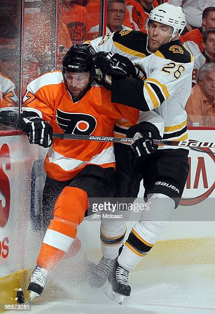 Ryan Parent of the Philadelphia Flyers is checked off the puck by Blake Wheeler of the Boston Bruins in Game Three of the Eastern Conference...