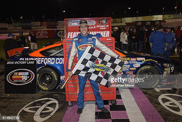 Ryan Partridge driver of the Sunrise Ford/Eibach Springs/Lucas Oil Ford poses with the trophy in victory lane after winning the NASCAR KN Pro Series...