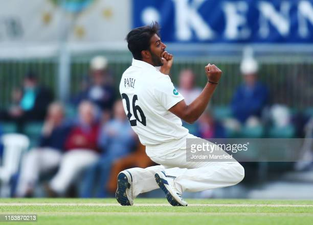 Ryan Patel of Surrey celebrates dismissing James Hildreth of Somerset during day three of the Specsavers County Championship Division One match...