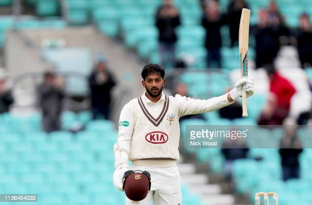 Ryan Patel of Surrey celebrates scoring his maiden century during the Specsavers County Championship Division 1 match between Surrey CCC and Essex...