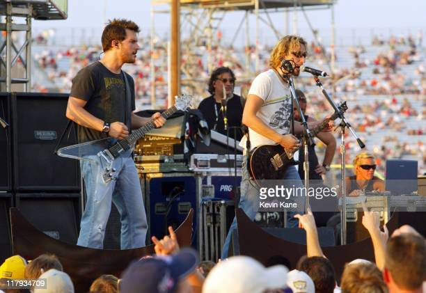 Ryan Peake and Chad Kroeger of Nickelback live during prerace of the NASCAR Nextel Cup Chevy Rock Roll 400 at the Richmond International...