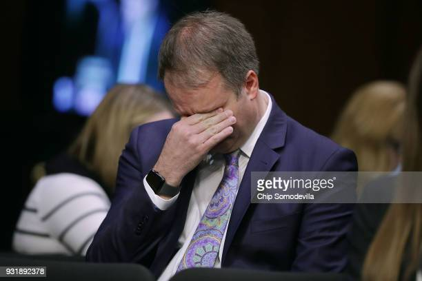Ryan Petty father of Alaina Petty a student killed in the February 14 shooting in Parkland Florida wipes away tears while hearing testimony from...