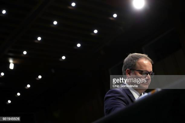 Ryan Petty father of Alaina Petty a student killed in the February 14 shooting in Parkland Florida wipes away tears while testifying before the...