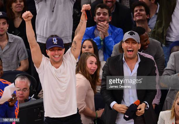 Ryan Phillippe and David Spencer attend the Washington Wizards vs New York Knicks game at Madison Square Garden on April 9 2013 in New York City