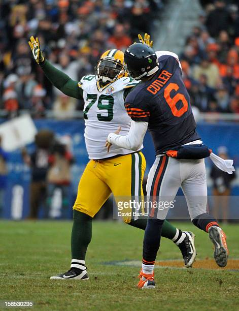 Ryan Pickett of the Green Bay Packers rushes Jay Cutler of the Chicago Bears on December 16, 2012 at Soldier Field in Chicago, Illinois. The Green...