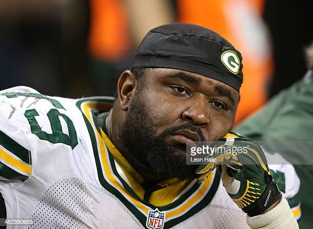 Ryan Pickett of the Green Bay Packers watches the final second on the clock run down during the game against the Detroit Lions at Ford Field on...