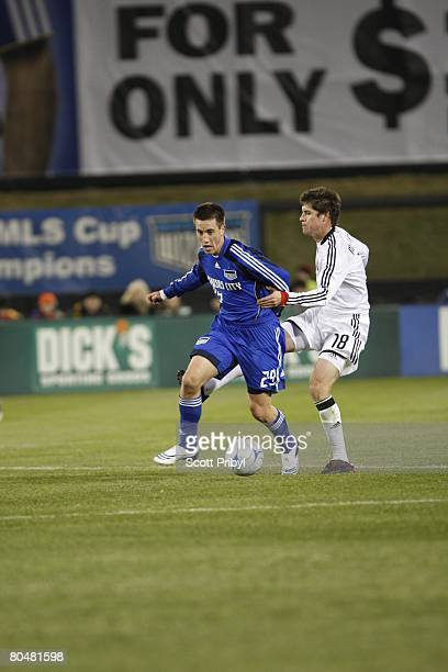 Ryan Pore of the Kansas City Wizards dribbles against Devon McTavish of DC United during the game at Community America Ballpark on March 29 2008 in...