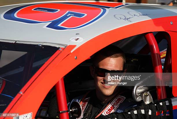 Ryan Preece driver of the East West Marine/Diversified Metals before the Hoosier Tire 200 at Riverhead Raceway on June 28 2014 in Riverhead New York