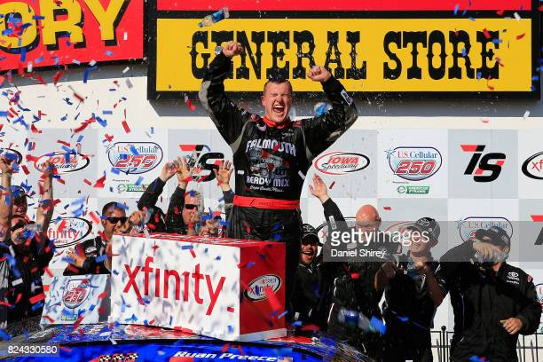 Ryan Preece driver of the MoHawk Northeast Inc Toyota celebrates in Victory Lane after winning the NASCAR XFINITY Series US Cellular 250 Presented by...