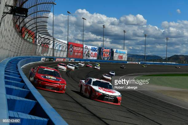 Ryan Preece driver of the Rheem Toyota leads Ross Chastain driver of the Daley Technology Systems Chevrolet during the NASCAR Xfinity Series Roseanne...