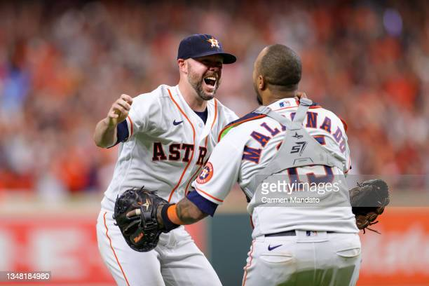 Ryan Pressly of the Houston Astros celebrates with Martin Maldonado after the final out in the ninth inning as they defeat the Boston Red Sox 5-0 in...
