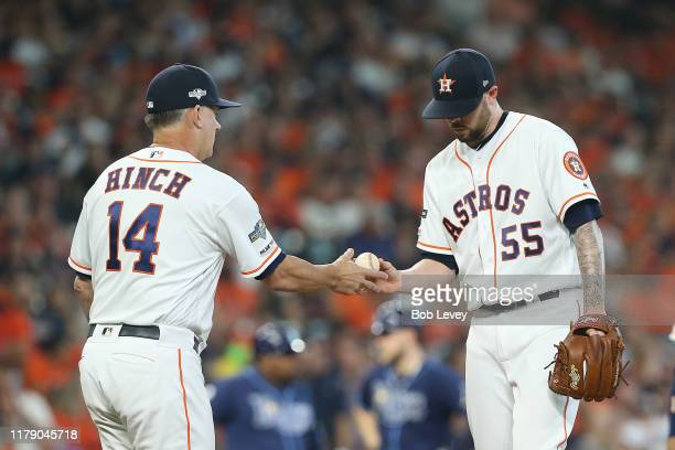Ryan Pressly of the Houston Astros is taken out of the game by manager AJ Hinch during the eighth inning against the Tampa Bay Rays in game one of...