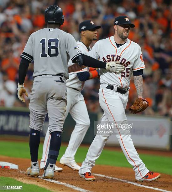 Ryan Pressly of the Houston Astros tags out Didi Gregorius of the New York Yankees in Game 6 of the American League Championship Series at Minute...