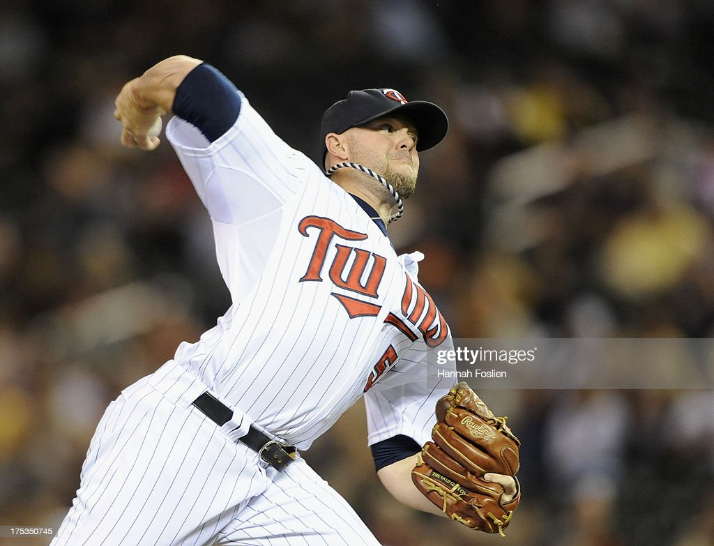 Ryan Pressly #57 of the Minnesota Twins delivers a pitch against the Houston Astros during the twelfth inning of the game on August 2, 2013 at Target Field in Minneapolis, Minnesota. The Twins defeated the Astros 4-3 in thirteen inning.