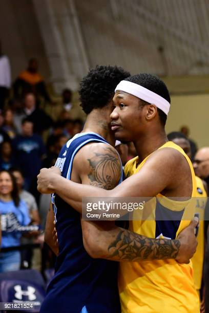 Ryan Preston of the Rhode Island Rams and Isiah Deas of the La Salle Explorers embrace after the game at Tom Gola Arena on February 20 2018 in...