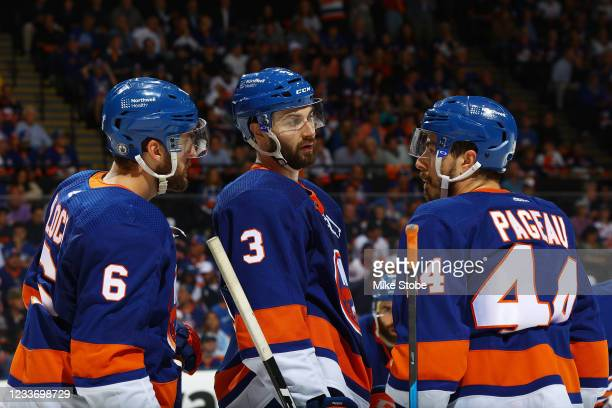 Ryan Pulock, Adam Pelech and Jean-Gabriel Pageau of the New York Islanders in action against the Tampa Bay Lightning in Game Six of the Stanley Cup...