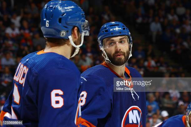 Ryan Pulock and Adam Pelech of the New York Islanders in action against the Tampa Bay Lightning in Game Six of the Stanley Cup Semifinals of the 2021...