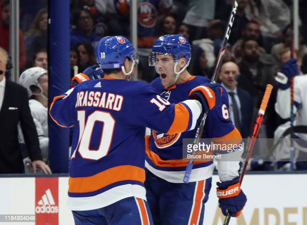 Ryan Pulock of the New York Islanders celebrates his goal at 11:33 of the second period against the Tampa Bay Lightning and is joined by Derick...