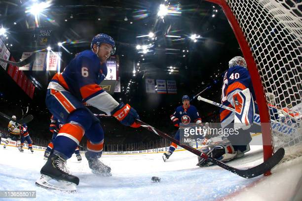 Ryan Pulock of the New York Islanders defends a shot against the Pittsburgh Penguins during the third period in Game Two of the Eastern Conference...