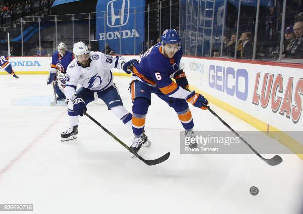 Ryan Pulock of the New York Islanders is checked by Nikita Kucherov of the Tampa Bay Lightning during the first period at the Barclays Center on...
