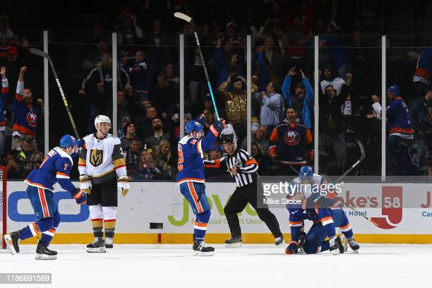 Ryan Pulock of the New York Islanders is congratulated by his teammates after scoring the gamewinning goal against the Vegas Golden Knights in...