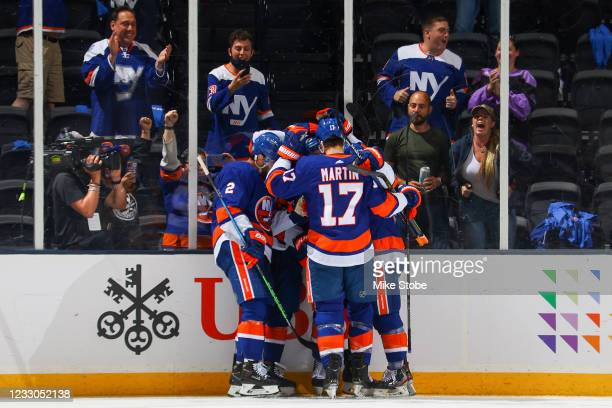 Ryan Pulock of the New York Islanders is congratulated by his teammates after scoring a goal against the Pittsburgh Penguins during the second period...