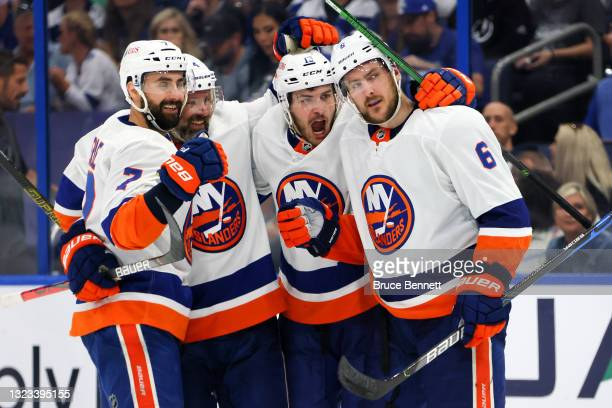 Ryan Pulock of the New York Islanders is congratulated by Jordan Eberle, Andy Greene and Mathew Barzal after scoring a goal against the Tampa Bay...