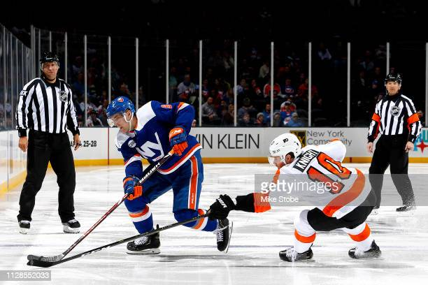 Ryan Pulock of the New York Islanders is defended by Corban Knight of the Philadelphia Flyers during the third period at NYCB Live's Nassau Coliseum...
