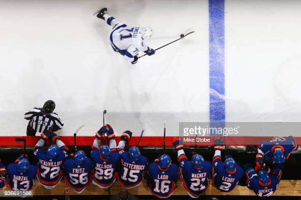 Ryan Pulock of the New York Islanders joins teammates Mathew Barzal Anthony Beauvillier Tanner Fritz Cal Clutterbuck Andrew Ladd Chris Wagner Nick...