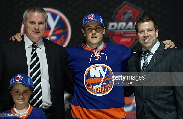 Ryan Pulock poses with General manager Garth Snow and Doug Weight Assistant Coach and Senior Advisor to the General Manager after being selected...