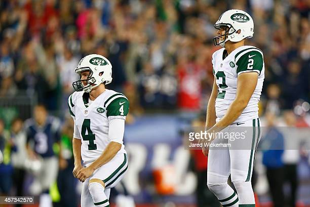 Ryan Quigley and Nick Folk of the New York Jets react after a blocked field goal attempt on the last play of the game during the fourth quarter...