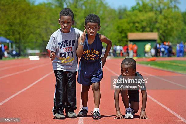 Ryan Quinn Gerrod Mayo and Tyler JeanBaptiste ready for the 50meter race for 5yearolds at the Springarn High Schoool in Washington DC on May 4 2013...