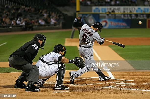 Ryan Raburn of the Cleveland Indians hits a three-run home run in the 1st inning against the Chicago White Sox at U.S. Cellular Field on September...