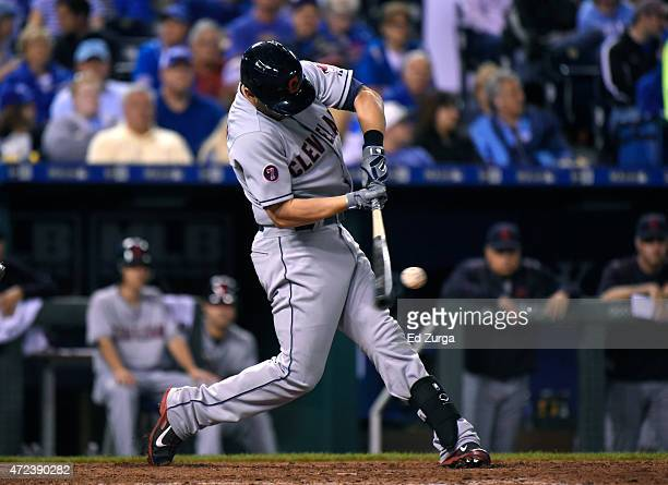 Ryan Raburn of the Cleveland Indians hits an RBI double in the seventh inning against the Kansas City Royals at Kauffman Stadium on May 6, 2015 in...