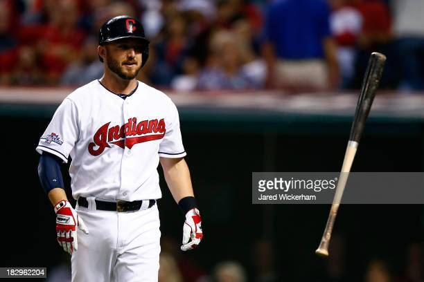 Ryan Raburn of the Cleveland Indians reacts after striking out in the eighth inning against the Tampa Bay Rays during the American League Wild Card...