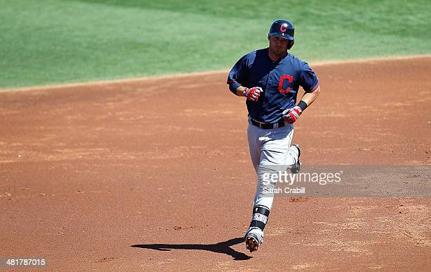 Ryan Raburn of the Cleveland Indians rounds the bases after hiting a home run during a game against the Cincinnati Reds at Goodyear Ballpark on March...