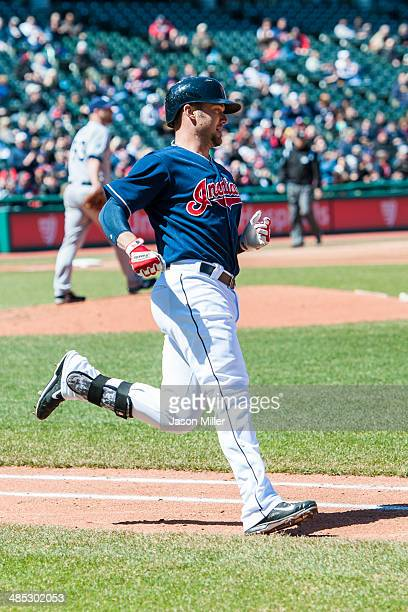 Ryan Raburn of the Cleveland Indians runs to first after hitting a fly ball during the second inning against the San Diego Padres during the first...