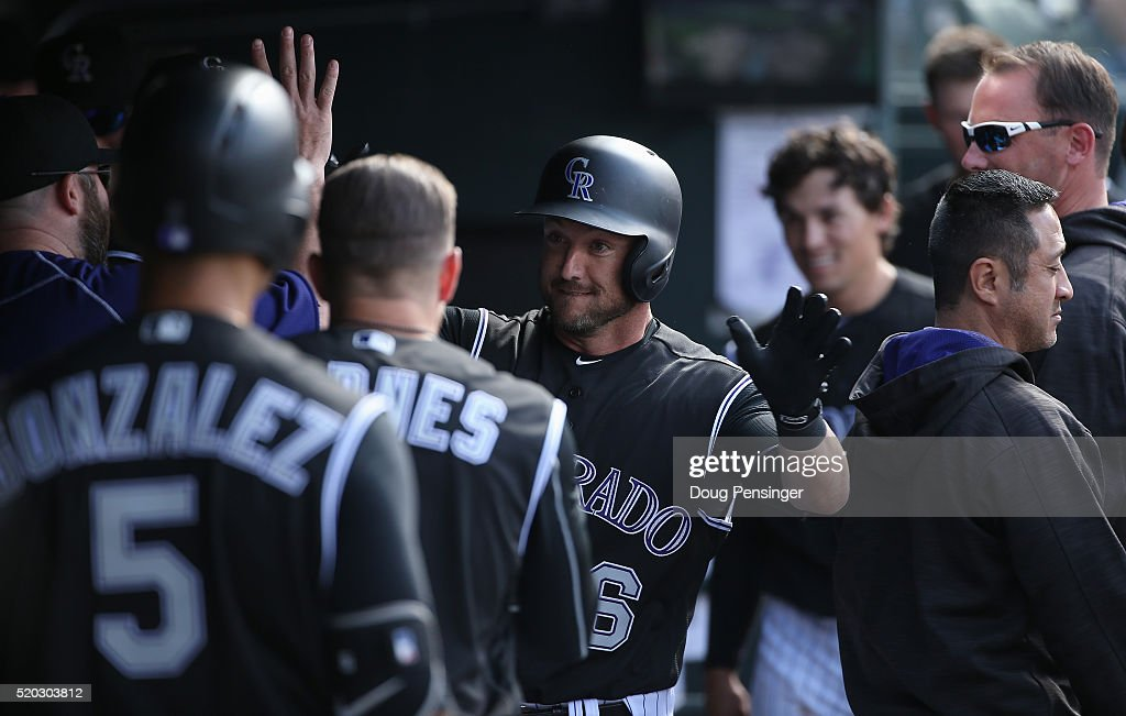 Ryan Raburn #6 of the Colorado Rockies celebrates his solo home run off of James Shields #33 of the San Diego Padres to take a 4-2 lead in the seventh inning on April 10, 2016 in Denver, Colorado.