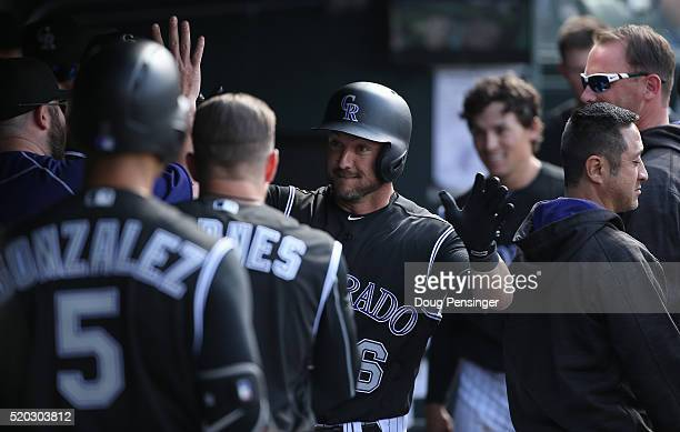 Ryan Raburn of the Colorado Rockies celebrates his solo home run off of James Shields of the San Diego Padres to take a 4-2 lead in the seventh...